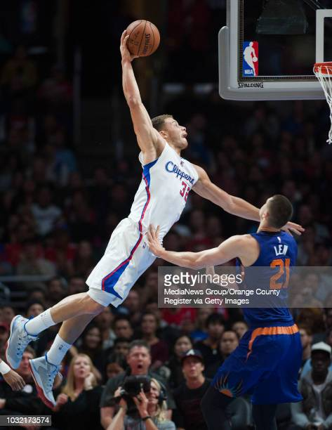 The Clippers' Blake Griffin dunks over the Suns' Alex Len during the second half of their basketball game at Staples Center Monday night INFO...