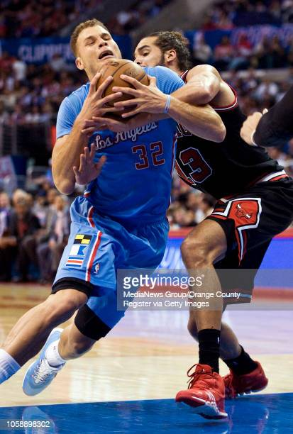The Clippers' Blake Griffin is fouled on his way to the basket by the Chicago Bulls' Joakim Noah at Staples Center in Los Angeles CA on November 24...