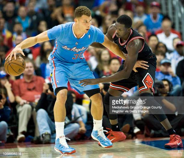 The Clippers' Blake Griffin tries to get past the Chicago Bulls' Luol Deng at Staples Center in Los Angeles CA on November 24 2013 The Clippers won...
