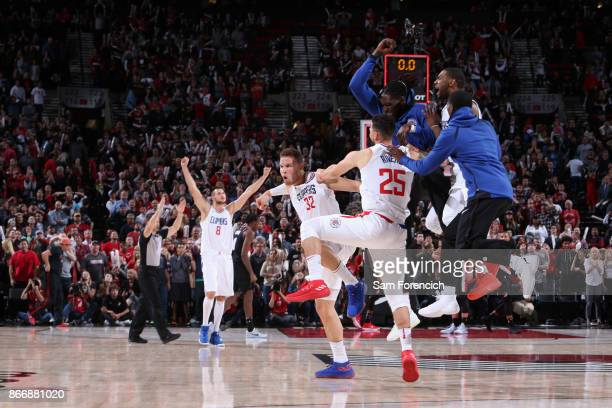 The LA Clippers celebrate after Blake Griffin of the LA Clippers hits the game winning shot against the Portland Trail Blazers on October 26 2017 at...