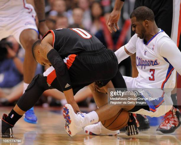 The Clippers' Chris Paul battles for a loose ball with the Trail Blazers' Damian Lillard during the Clippers' 122117 victory over Portland Wednesday...