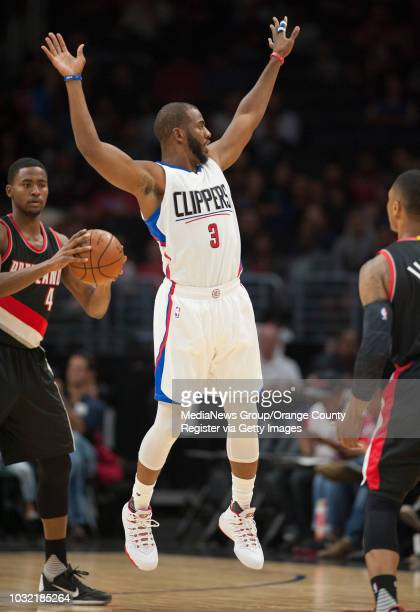 The Clippers' Chris Paul leaps while defending the Trail Blazers' Damian Lillard during the Clippers' 115109 victory over the Portland Trail Blazers...