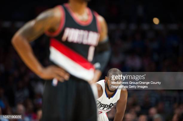 The Clippers' Chris Paul looks to the bench behind the Trail Blazers' Damian Lillard during the Clippers' 115109 victory over the Portland Trail...