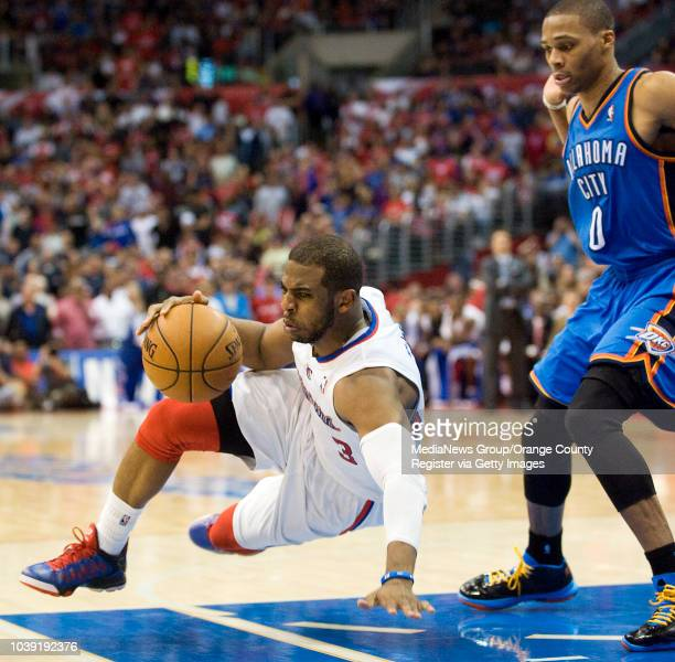 The Clippers' Chris Paul slips while trying to get around the Oklahoma City Thunder's Russell Westbrook during their game at Staples Center on March...