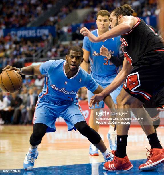 The Clippers' Chris Paul tries to get past the Chicago Bulls' Joakim Noah at Staples Center in Los Angeles CA on November 24 2013 The Clippers won...