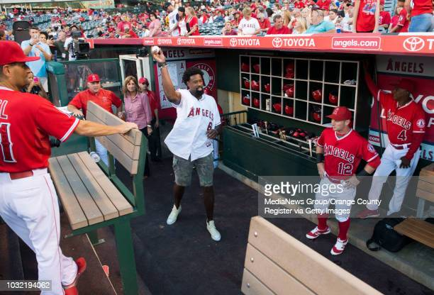 The Clippers' DeAndre Jordan warms up in the dugout before throwing out the first pitch at Angel Stadium Tuesday INFO angels0819kjs Photo by KEVIN...