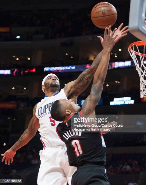 The Clippers' Josh Smith blocks a shot by the Trail Blazers' Damian Lillard during the Clippers' 115109 victory over the Portland Trail Blazers in...