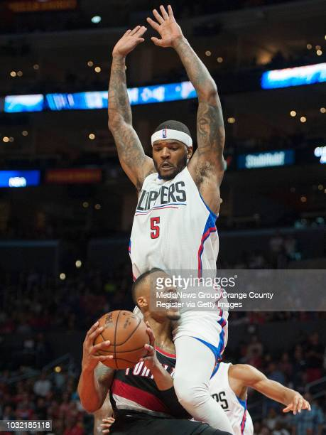 The Clippers' Josh Smith gets some elevation while defending the Trail Blazers' Damian Lillard during the Clippers' 115109 victory over the Portland...