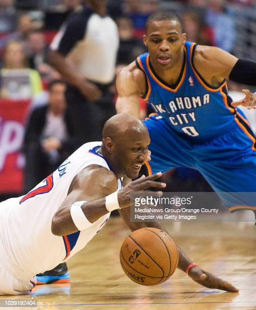 The Clippers' Lamar Odom goes for a loose ball in front of the Oklahoma City Thunder's Russell Westbrook during their game at Staples Center on March...