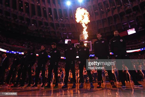 The LA Clippers line up for the national anthem before the game against the Golden State Warriors on April 7 2019 at ORACLE Arena in Oakland...