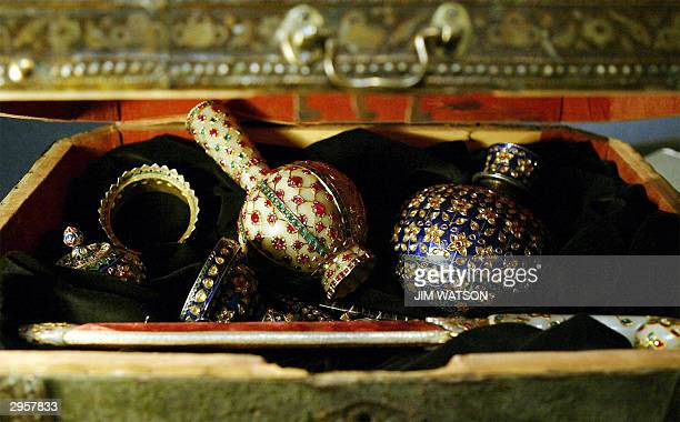 The Clive of India treasure rests in a case at Christie's auction house in London 10 February 2004 with a jewelled jade flask in the center The jade...
