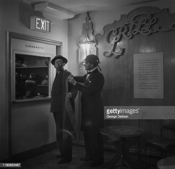 The cloakroom at the Hungaria a Hungarian restaurant on Lower Regent Street in London which also acts as an air raid shelter with beds for its...