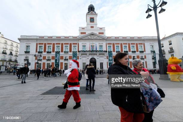 The clock at 'Puerta del Sol' or Government Clock of 'Casa de Correos' that every year rings the traditional New Year's Eve grapes during midnight on...