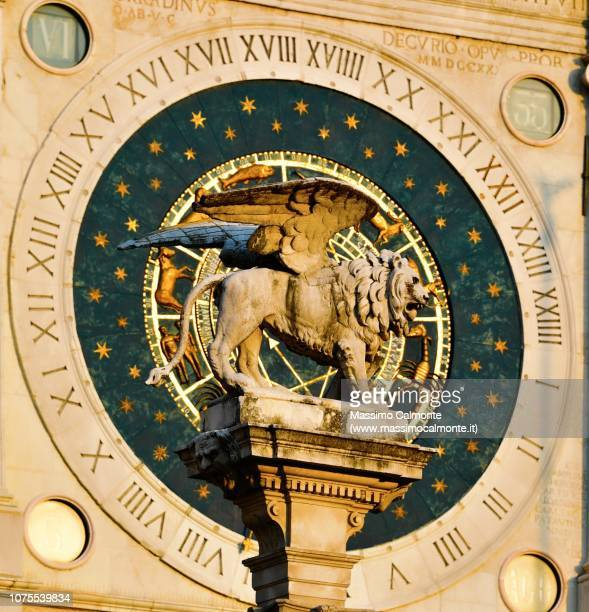 the clock in plaza piazza dei signori with the venice san marco lion - calendar icon stock photos and pictures