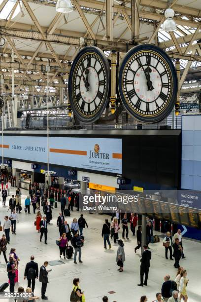 the clock inside waterloo station london is a famous meeting point for those meeting passengers arri - waterloo railway station london stock pictures, royalty-free photos & images