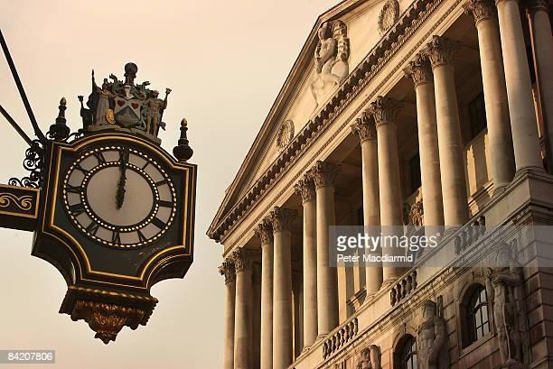 The clock on the Royal Exchange building shows midday in front of the Bank of England on January 8 2009 in London At midday The Bank announced a cut...