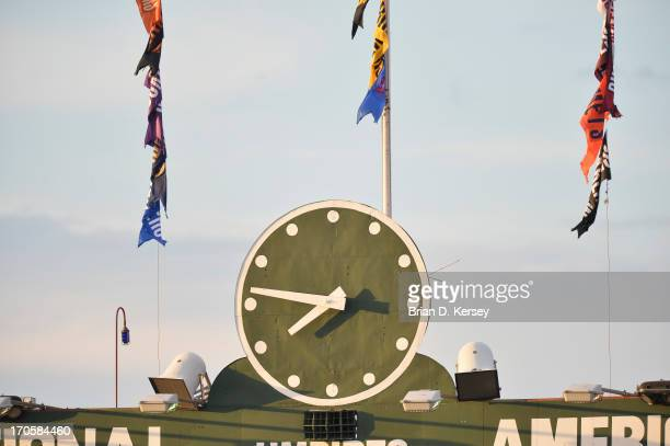 The clock on the scoreboard approaches 8pm during the Chicago Cubs Cincinnati Reds game at Wrigley Field on June 11 2013 in Chicago Illinois The Reds...