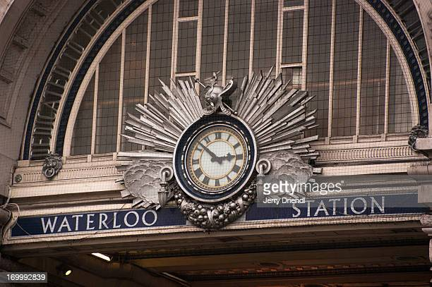 the clock over the entrance to waterloo station - waterloo railway station london stock pictures, royalty-free photos & images