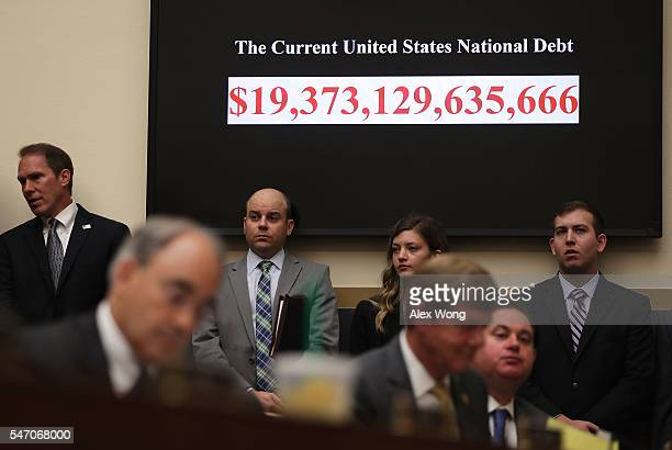 The clock that shows the figure of current national debt of the United States of America is seen during a hearing before the House Financial Services...