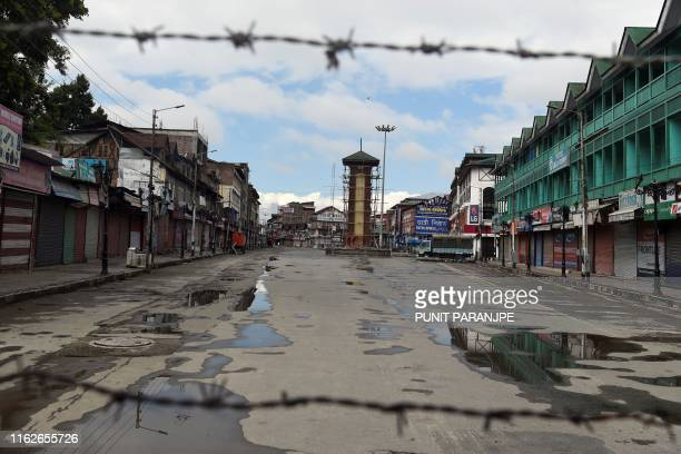 TOPSHOT The clock tower at deserted Lal Chowk is pictured during a security lockdown in Srinagar on August 19 2019 India on August 5 ended the...