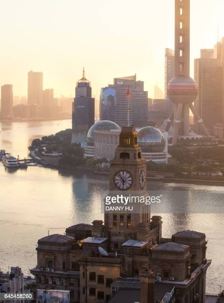 the clock tower building in shanghai bund in the morning - huangpu river stock photos and pictures
