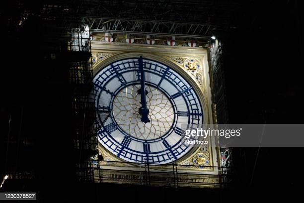 "The clock-face on the Elizabeth Tower, commonly known by the name of the bell, ""Big Ben"" shows 2400 , early on New Year's Day in London,..."