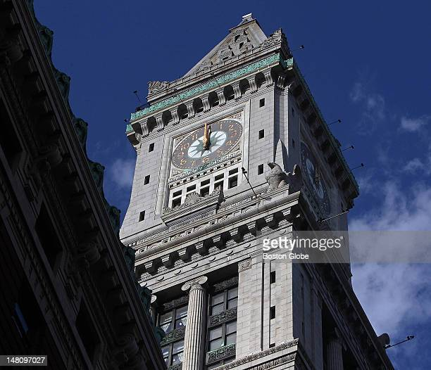 The clock's hands are at 12 o'clock before David Hochstrasser not pictured works on resetting the famous clock on the top of the Custom House Tower