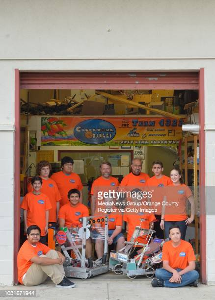 The Clockwork Oranges robotic team at El Modena High School with their robots Tim left and Fred in Orange on Friday The members are Andrew Nava...