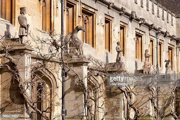 The Cloister of Magdalen College in Oxford with statues and wisteria