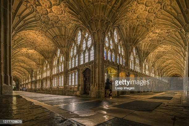 The cloisters of Gloucester Cathedral have a fan vaulted ceiling dating from the 14th Century.