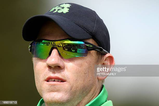 The Clontarf cricket grounds are reflected in the sunglasses of Ireland's wicketkeeper Niall O'Brien during the One Day International cricket match...