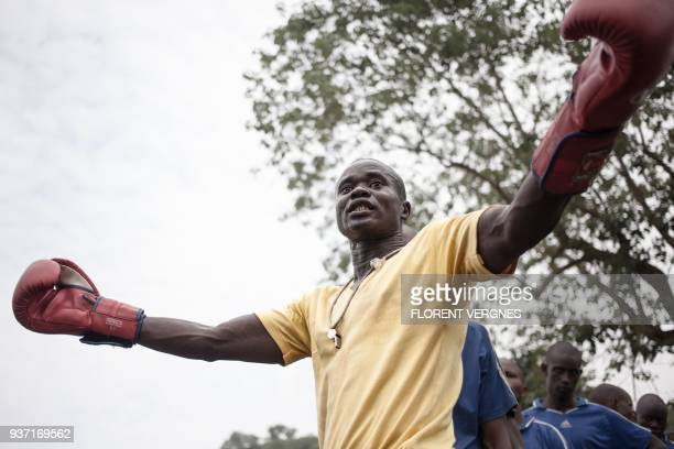 The close combat instructor gives a course to former militiamen of armed groups ready to be integrated into the regular army at Camp Kassai in Bangui...