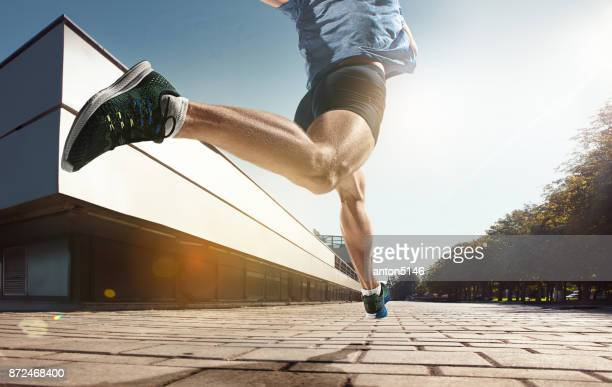 The close up feet of man running and training on running track