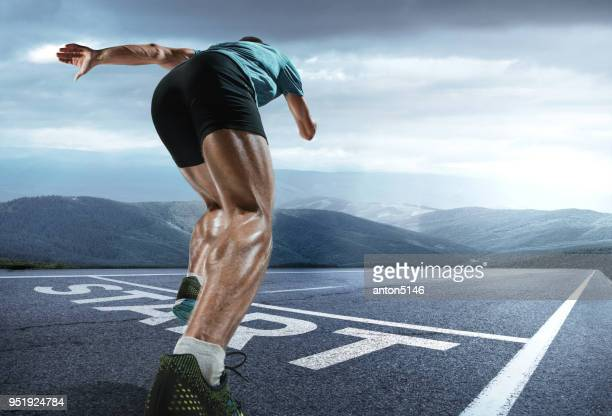 the close up feet of man running and training on running track with word start - beginnings stock pictures, royalty-free photos & images