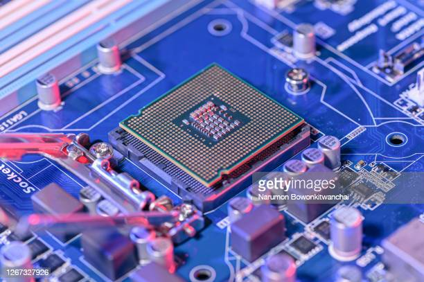 the close up image of the cpu socket and motherboard laying on the table - computer chip stock pictures, royalty-free photos & images