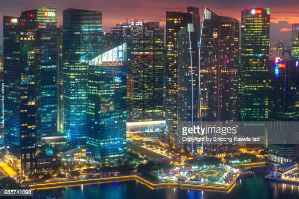 The close up view of the Central Business District (CBD) around the Marina Bay in Singapore in twilight time.