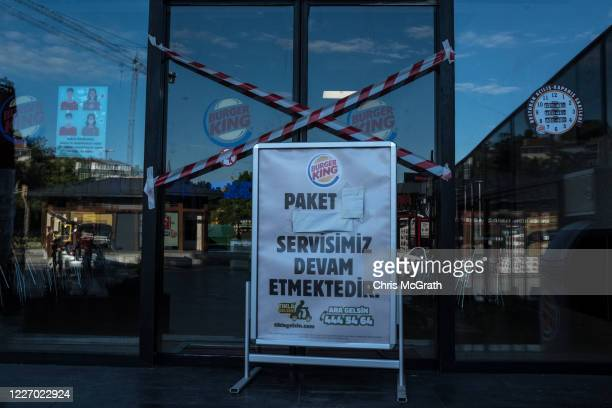 The closed entrance to a Burger King restaurant is seen on the second day of the Muslim holiday of Eid alFitr during a fourday lockdown to help stop...