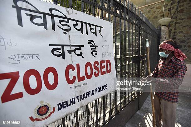 The closed entry gate of the National Zoological Park as Delhi zoo has been temporarily shut after the death of nine birds on October 19 2016 in New...