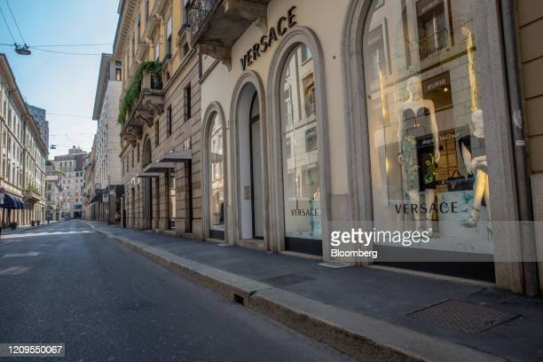 The closed Gianni Versace Srl boutique stands on Via Monte Napoleone the fashion district artery in Milan Italy on Wednesday April 8 2020 Italy is...