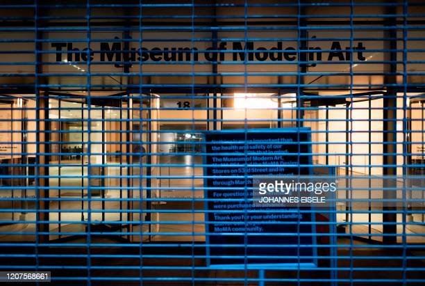 The closed Museum of Modern Art is pictured in Manhattan on March 17 2020 in New York City The coronavirus outbreak has transformed the US virtually...