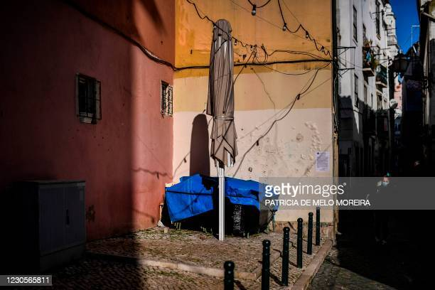 The closed terrace of a bar is pictured in Alfama neighbourhood in Lisbon on January 13, 2021. - Portugal is expected to announce today a new...