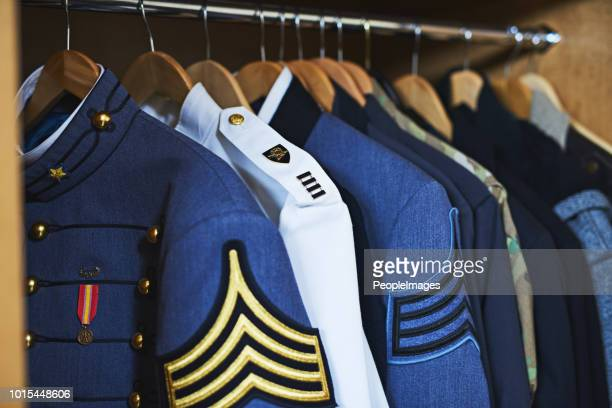 the closet of heroes - us military emblems stock pictures, royalty-free photos & images