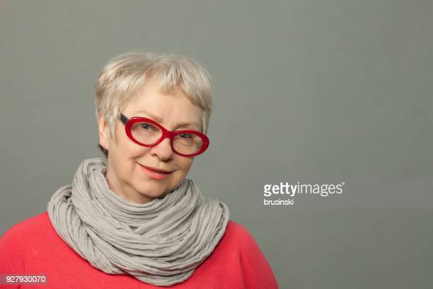 the closeup studio portrait of the attractive senior 65-years-old woman - 65 69 years stock pictures, royalty-free photos & images