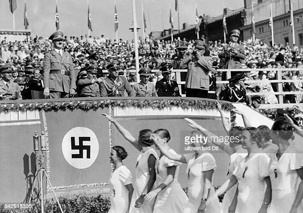 The closing announcement with Adolf Hitler on the honour tribune at the Friesenwiese in the foreground the female members giving the 'Deutscher...