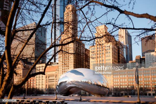 """the cloud gate or """"bean"""" at sunrise on a winter day - cloud gate stock photos and pictures"""