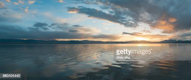 the cloud of the chaka salt lake - sunset lake stock photos and pictures