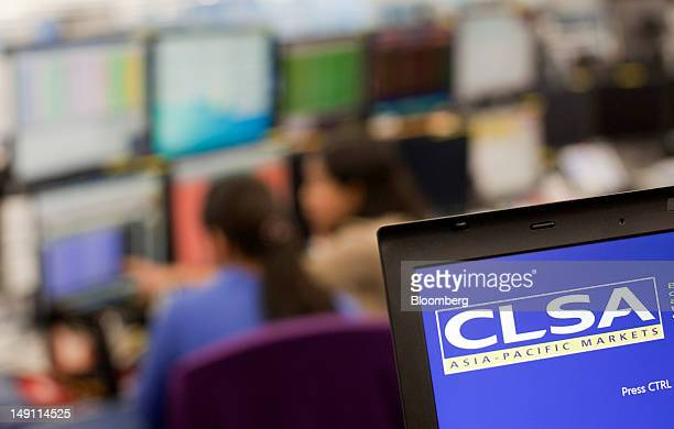The CLSA AsiaPacfic Markets logo is displayed on a computer monitor at the company's offices in Hong Kong China on Monday July 23 2012 Citic...