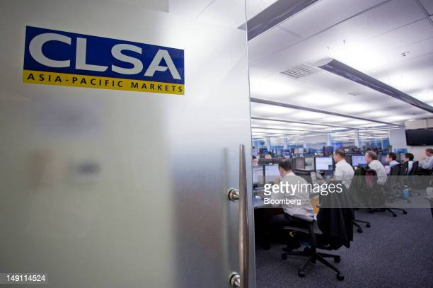 The CLSA AsiaPacific Markets logo is displayed on an office door at the company's offices in Hong Kong China on Monday July 23 2012 Citic Securities...