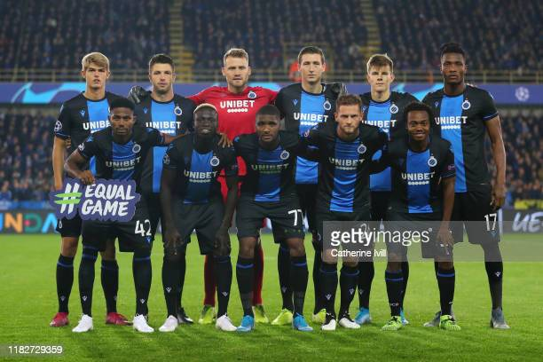 The Club Brugge KV players pose for a team photo prior to the UEFA Champions League group A match between Club Brugge KV and Paris Saint-Germain at...