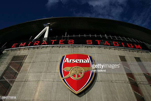 The club crest and stadium name high on the recently finished Emirates Stadium home to Arsenal Football Club in North London